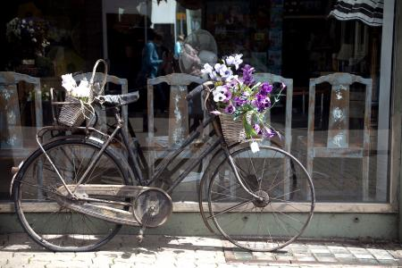Bicycle outside shop with flowers