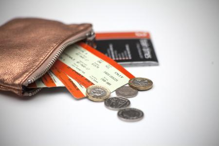 Wallet with coins and train tickets
